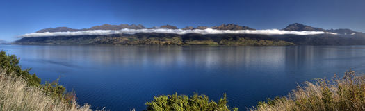 Incredible Cloud and Mountain Panorama. Panorama of lake and mountains in New Zealand Stock Photo