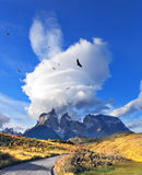Incredible clouds above the cliffs. Amazing sunset in the Chilean Patagonia. Incredible clouds above the cliffs of Los Kuernos in national park Torres del Paine Royalty Free Stock Photo