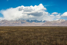 Incredible color of the sky and clouds over flat Tibetan plain Royalty Free Stock Image