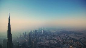 Incredible drone aerial flight over futuristic Dubai city skyscraper towers in foggy morning sunrise. Drone aerial flight over futuristic Dubai city skyscraper stock footage