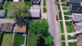 Incredible drone panorama aerial tilt shift view on tiny houses villas in suburb town village neighborhood. Fascinating drone panorama aerial tilt shift view on stock video footage