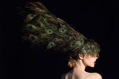 Incredible fashion beauty portrait of attractive girl model with peacock feathers. Stock Photo