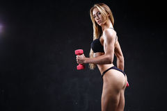 Incredible fitness model on the dark background Royalty Free Stock Image