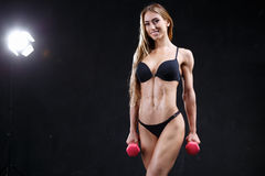 Incredible fitness model on the dark background Stock Photos
