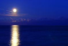 Incredible full moon reflected in the sea Royalty Free Stock Images