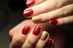 An incredible glow under red stained gel polish Royalty Free Stock Image