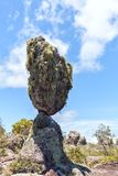An incredible huge stone balances on a thin support. Natural phenomenon Royalty Free Stock Image