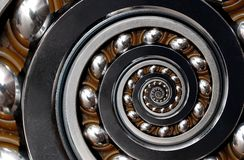 Incredible Industrial Spiral ellipse Ball Bearing rim. Spiral level bearing manufacturing technology. Unusual abstract texture fra. Ctal pattern background royalty free stock photos