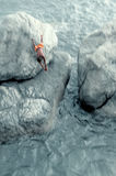 An incredible jump from a cliff Stock Images