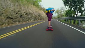 Incredible 4k first person pov on professional skater skating longboard fast downhill asphalt road in mountain landscape stock video