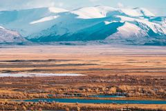 Incredible landscape of the steppe area with lakes and trees smoothly turning into mountains with snow-capped peaks. Mountains Of Altai Stock Photos