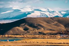 Incredible landscape of the steppe area with lakes and trees smoothly turning into mountains with snow-capped peaks. Mountains Of Altai Stock Photo