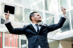 Incredible luck. Happy businessman celebrates his success. young Stock Image