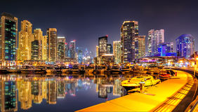 Incredible night dubai marina skyline. Luxury yacht dock. Dubai, United Arab Emirates. Stock Photos