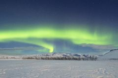 Northern light with snow landscape royalty free stock image