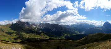 Incredible panoramic view of dolomite mountain scenery. Panoramic view of beautiful dolomite mountain scenery in south tyrol / gardena valley in italy royalty free stock photography