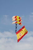 Incredible paratroopers. Exercises conducted by paratroopers in the air festival held in Cadiz, carrying the Spanish flag Royalty Free Stock Image