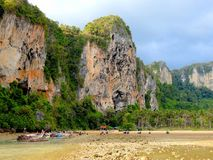 Amazing scenery on a Thai beach. Incredible scenery on a Thai beach, with its rock formations, mountains, and lots of greenery stock images