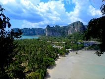 Amazing scenery on a Thai beach. Incredible scenery on a Thai beach, with its rock formations, mountains, and lots of greenery stock photos