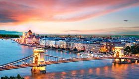 Incredible spectacular picturesque sity landscape of the Parliament and the bridge over the Danube in Budapest, Hungary, Europe at. Sunset. Charming places stock photo