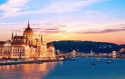 Incredible spectacular picturesque sity landscape of the Parliament and the bridge over the Danube in Budapest, Hungary, Europe at. Sunset. Charming places stock photos
