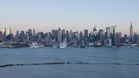 Stunning steady 4k day to night time lapse panorama of big modern New York city Manhattan downtown ship port waterfront. Incredible steady 4k day to night time stock footage