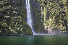 Incredible Stirling Falls with double rainbow, Milford Sound, Fi Stock Photos