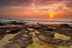 Incredible sunrise. Magical sunrise with the sun peeping through the orange sky Stock Photo