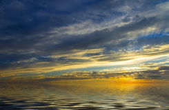 Incredible sunset above calm water Stock Photography