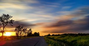 Road to Heaven. Incredible sunset captured next to road that leads in nowhere Royalty Free Stock Photography
