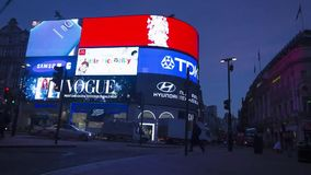 Incredible time lapse view on flashing advertisement big electronic screen on London Piccadilly Circus downtown building stock video