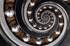 Incredible unrealistic surreal industrial Ball Bearing spiral abstract pattern background. Spiral machinery abstract surreal Stock Images