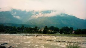 An incredible view of river, cloud and mountains in Manali, India stock photo