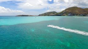 Jet ski and yachts at Saint Martin Caribbean Island. Incredible view of the transparent waters of Saint Martin Royalty Free Stock Photos
