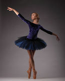 Incredibly beautiful ballerina in blue outfit posing and dancing Stock Images