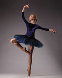 Incredibly beautiful ballerina in blue outfit is posing in studio. classical ballet art. royalty free stock photos