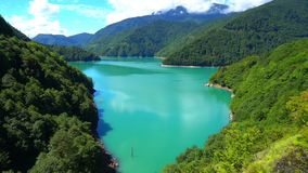 Incredibly beautiful blue lake in the mountains stock video footage