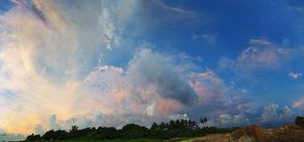 Incredibly beautiful sky over tropical coast at sunset. Sri Lank Royalty Free Stock Photography