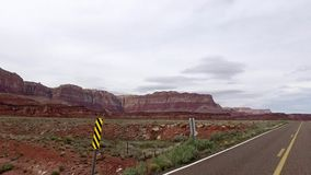 Incredibly beautiful spring landscape in Utah. Road driving POV. Geological formation weather water erosion. Nature
