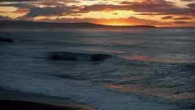 Incredibly beautiful sunset on the beach. Sun, sky, sea, waves and sand stock video footage