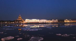 Incredibly beautiful view of the Neva river and St. Isaac`s Cathedral at night. Illumination of streets and buildings in Spb Stock Images