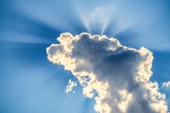 Incredibly dramatic clouds with the bright rays of the sun that breaks through. Them royalty free stock photography