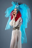 Incredibly fashion girl with red hair in crown and veil Stock Photo