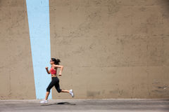 Incredibly fit woman out for a run, Stock Photos