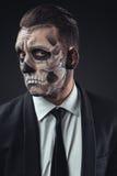 Incredulous businessman with makeup skeleton Stock Photo