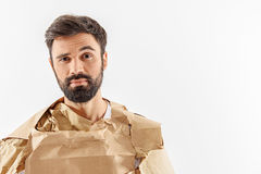 Incredulous male person wearing paper Stock Images
