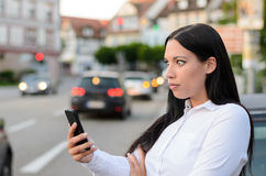 Incredulous woman reading a message on a mobile Stock Image