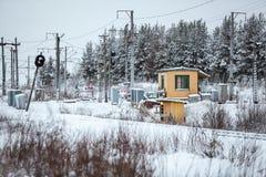 Incrocio della ferrovia nella stagione invernale Fotografie Stock