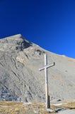 Incrocio di legno su un passo di montagna Fotografia Stock