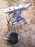 Incudine e ferro di cavallo Fotografia Stock